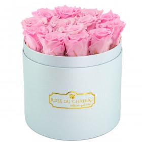 Rose eterne rosa pallido in flowerbox azzurro