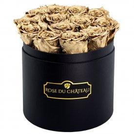 Zlaté věčné růže v černém kulatém flowerboxu